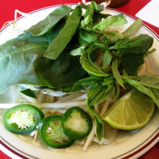 The perfect pho benefits from a generous heap of Thai sweet basil, bean sprouts, and jalapeno peppers.  And oh, a squeeze of fresh lime!
