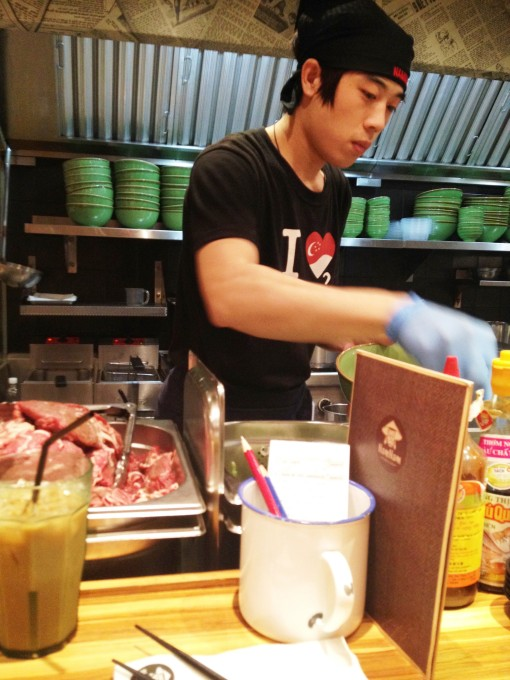"""Seated by the bar, I had a full view of how my steaming hot bowl of """"Phở Beef Steak Slices"""" was prepared."""