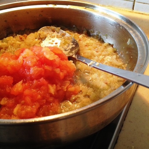 Turn the heat up to allow the tomatoes to breakdown into a sauce.