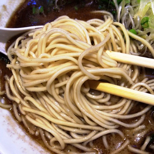It is necessary to start enjoying the ramen – any ramen for that matter – by first tasting the noodles.  Notice how I have carefully moved the negi to one side while I fish out the noodles.