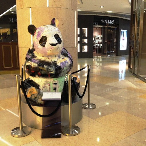 "Like slices of medium rare lamb strewn atop mesclun greens, contemporary pieces of art are scattered all over ION on Orchard.  And it has to be said, beautifully so.  This one is the ""BA PANDA"", a painted bronze sculpture, by Julien Marinetti."