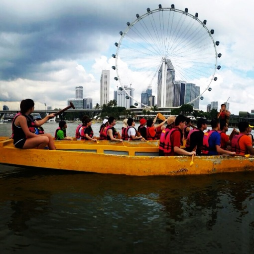 My fellow first-time paddlers against the backdrop of the awesome Singapore skyline at daylight, anchored on to the image of the Singapore Flyer.  This is my favorite from all the photos taken.