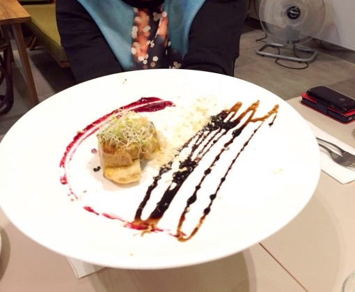 This place gets mad props from me on presentation.  This humongous pristine white plate dwarfs the sliver of pan-fried foie gras nestled on a piece of garlic toast, meant to be stained with the dried fruit compote and dusted with a little bread crumbs.